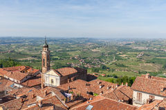 Red roofs of La Morra and green hills of Piedmont. Stock Photo