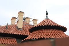Original round red roofs in Prague stock images