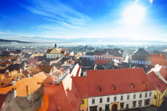 Red roofs and shining sun in Sibiu, Romania Stock Photography