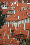 Red rooftops of houses. Aerial view of red tiled rooftop of houses in city of Prague, Czech Republic Stock Images