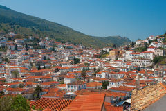 Red rooftops of houses on Hydra Island Stock Photo