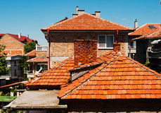 Red rooftops of old residential houses Stock Photo