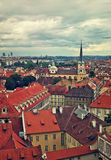 Red rooftops under cloudy sky in Prague. Royalty Free Stock Photo
