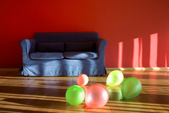 Red room with blue sofa with balloons Royalty Free Stock Photo