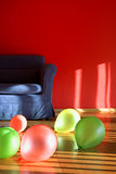 Red room with blue sofa with balloons Stock Photo