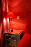 Red room by lamplight. Warm glow of soft lighting in red-themed room Royalty Free Stock Photos