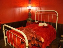Red Room in an 1880s town in South Dakota. Original bed and bedsheets inside the red room of a pub in an 1880s village in South Dakota royalty free stock images
