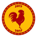 Red rooster in a round frame with an ornament in the rhomb. Vector Royalty Free Stock Photography
