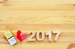 Red rooster, symbol of 2017 on the Chinese calendar. Lollipop in the form of a red rooster on a wooden background stock images