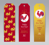 Red Rooster symbol of 2017. Vector vertical tags with illustration of rooster, symbol of 2017 on the Chinese calendar. Silhouette of red cock, decorated with Royalty Free Stock Photo