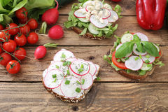 Red roots sandwiches. Red roots and tomatoes sandwiches Royalty Free Stock Photos