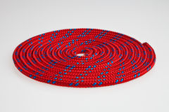 Red rope. Red line rolled flat isolated over white background Royalty Free Stock Images