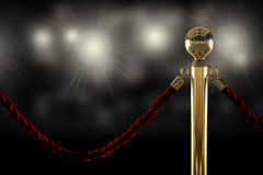 Red rope barrier close-up. Red velvet rope barrier close-up with flash light on background Royalty Free Stock Photo