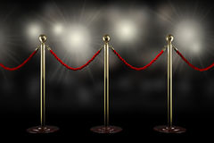 Red rope barrier. Three rope barrier and red velvet cord with flash light Royalty Free Stock Photo