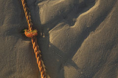 Red rope on the beach Royalty Free Stock Photos