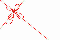 Red rope and bow Royalty Free Stock Photo