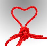The red rope heart. Stock Photos