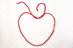 Red rope heart on white mulberry paper Stock Images