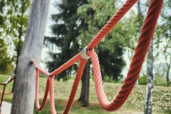 Red rope loop wooden playground mannheim kids play fun happy nature eco sand climbing metal stock images