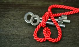 Red rope with silver keys Stock Photos