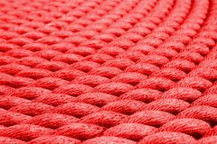 Red rope - on the Tall Ship in Glasgow. A coil of rope on The deck of The Tall Ship in Glasgow Stock Photo