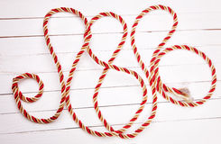 Red rope on a white background wooden table. Red rope on a white  wooden table Stock Photos