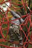 Red ropes. Little boy is playing on a playground with red ropes Stock Photo