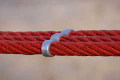 Red ropes and metal part 1. Composition of red ropes and metal part with sunlight Royalty Free Stock Image