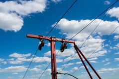 Red ropeway cablecaar construction against blue sky and beautiful white clouds Stock Photography