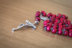 Red rosary beads with crucifix Royalty Free Stock Photography
