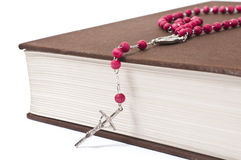 Red rosary on a book Stock Image