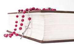 Red rosary on a book Stock Photos