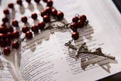 Red rosary and holy bible. Shot with dramatic lighting Royalty Free Stock Photos