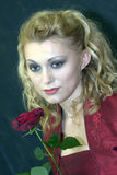 Red rose. Portrait of the beautiful young woman holding single red rose flower Royalty Free Stock Photos