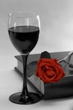 Red rose. Wineglass, book and red rose Stock Images