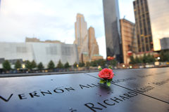 Red rose on 911 memorial. A shot of a red rose laid on top of the names in 911 memorial Stock Photos