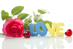 Red Rose And The Text Of LOVE Royalty Free Stock Images