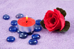 Red  rose and aroma candle on the towel Stock Photo