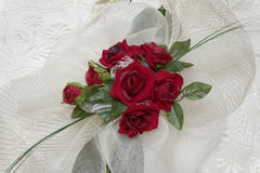 Red rose on a background white silk. Wedding Red rose on a background white silk royalty free stock images