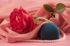 Red rose, beads and box Royalty Free Stock Images