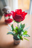 Red rose and bear doll Stock Photo