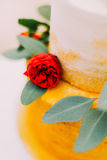 Red rose on the beautiful wedding cake close up Stock Photography