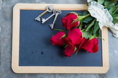 Red rose on blackboard Stock Photo