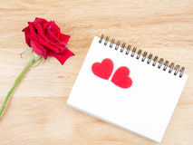 Red rose, blank notebook and heart shape 1 Royalty Free Stock Photos