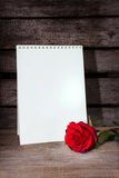 Red rose and blank  paper Stock Image