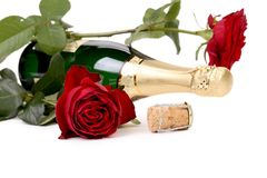 Red rose and a bottle of champagne. Royalty Free Stock Images