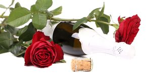 Red rose and a bottle of champagne. Stock Photography