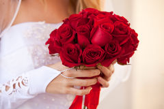Red Rose Bouquet. A Bride holding a Beautiful Red Rose Bouquet Stock Images