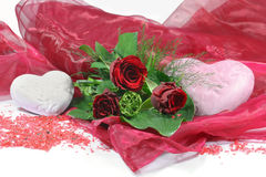 Red rose bouquet. And heart decorations isolated on white background Stock Photo