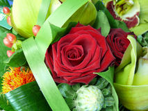 Red rose bouquet. A bouquet, focusing on the red roses. Typically given on Valentine's Day Royalty Free Stock Photography